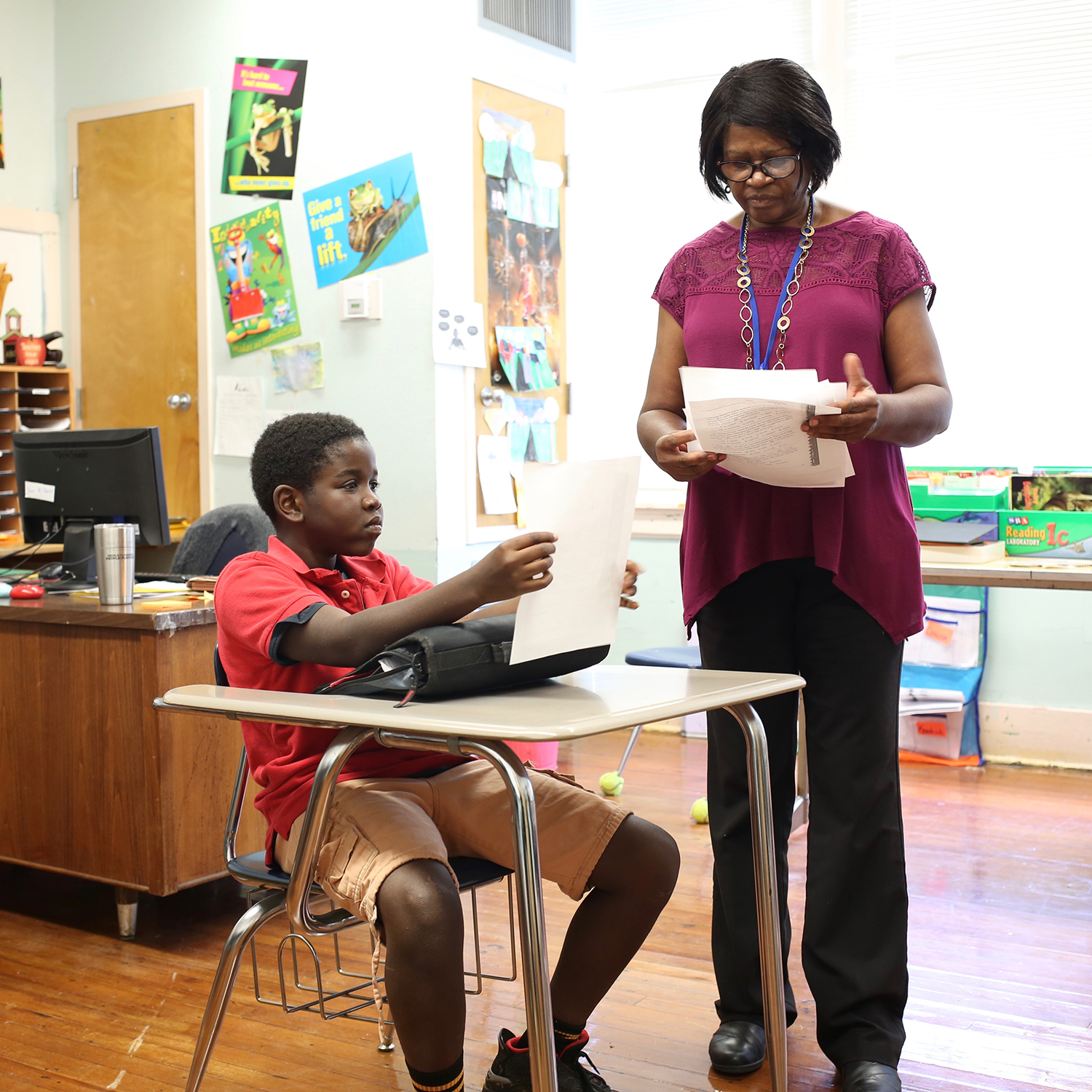 Mrs. McKenzie works with a QUE student.