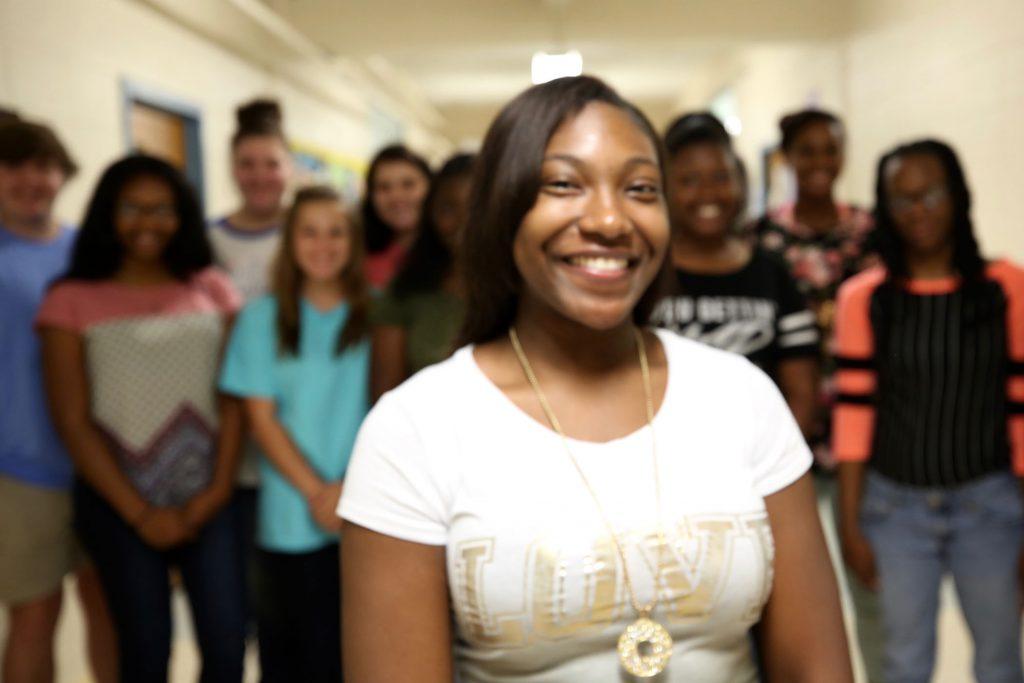 Ebony standing with fellow 2018 QHS graduates