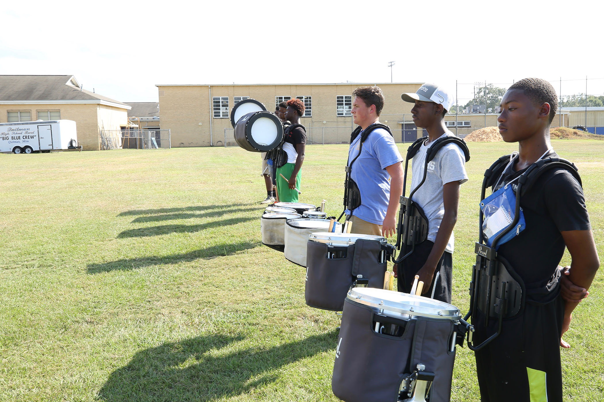 Tyshun practices with the drum line after school.