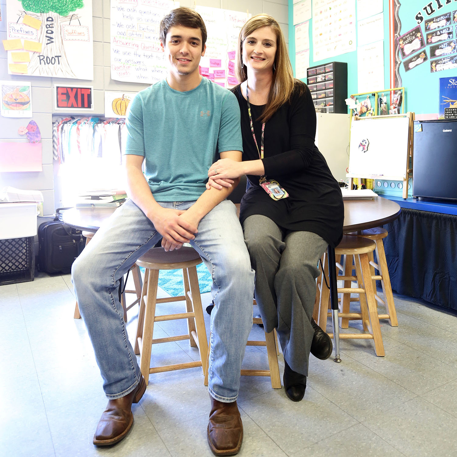 Bradley sits with his mom in her classroom at QLE.