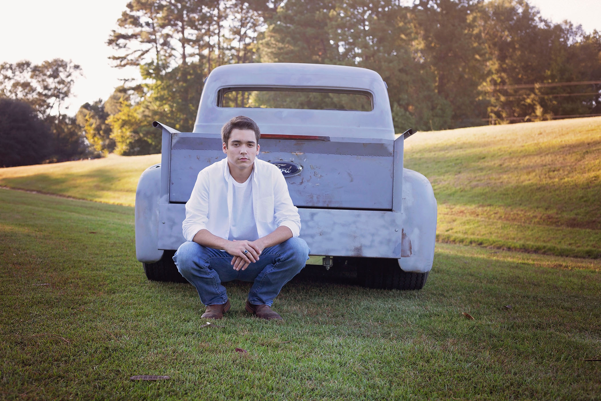 Bradley poses behind a truck on land in Clarke County, MS.
