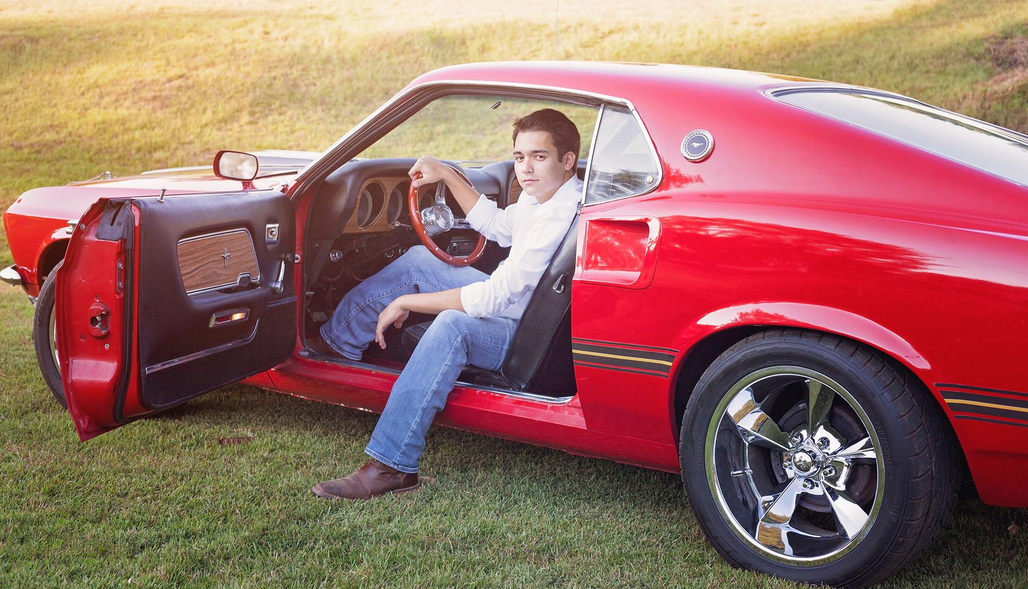 Bradley sits in his car.