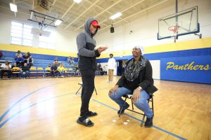 QHS senior is preparing to a deliver a pie in the face of a QHS teacher.