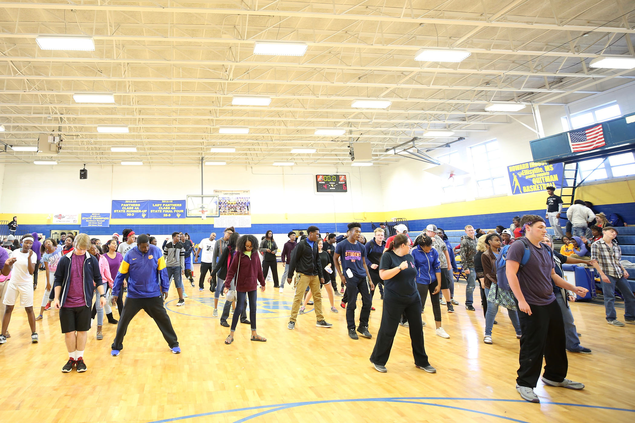 QHS students and faculty dance together.