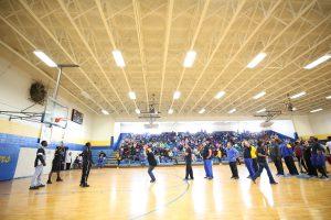 QHS teachers participate in a free throw contest.