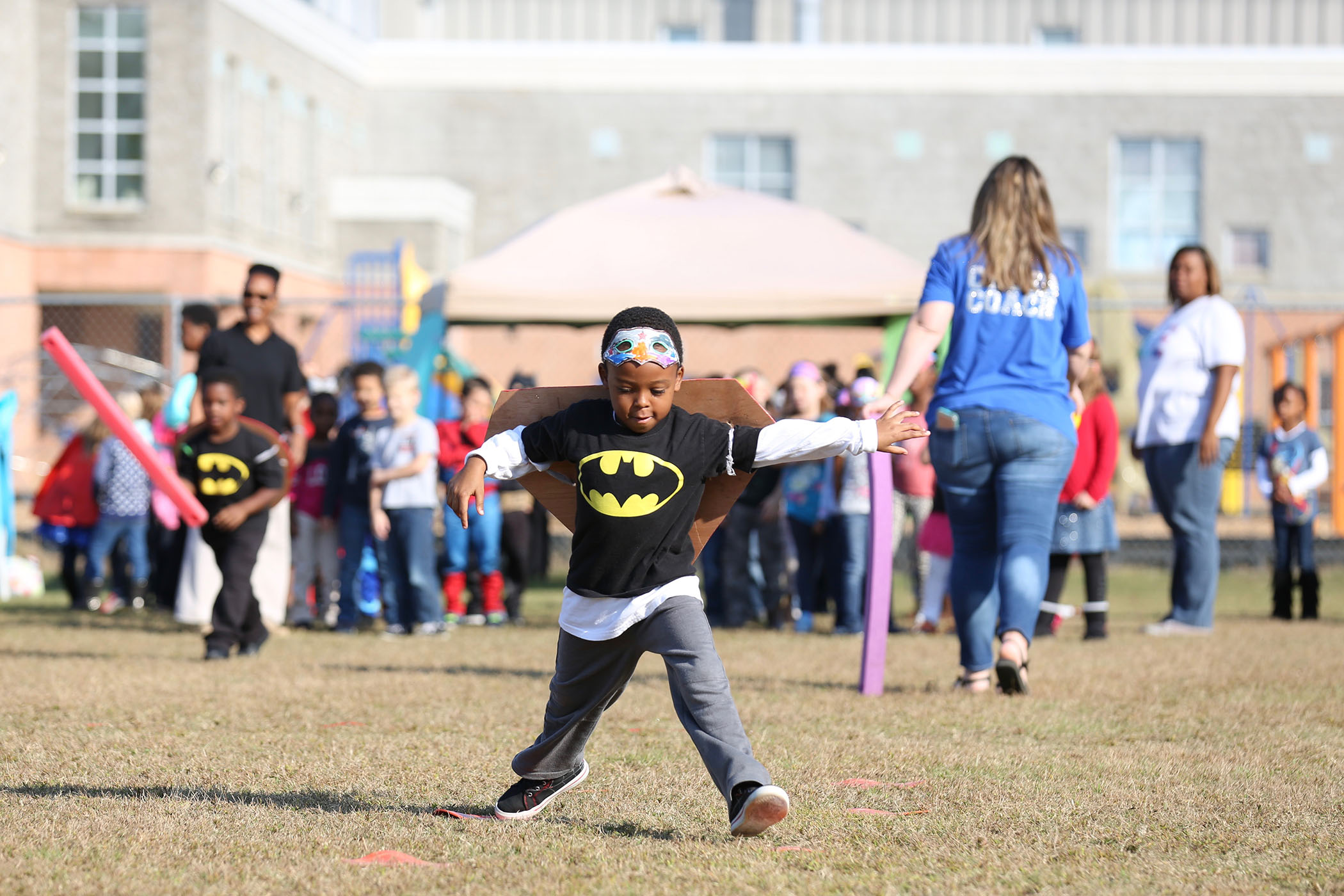 A QLE student competes in the fun run.