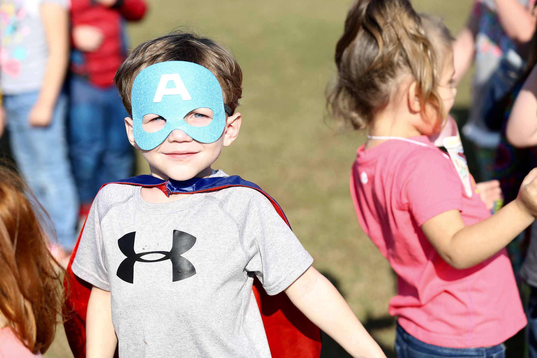 A QLE student stands in line waiting to participate in the QLE Fun Run.