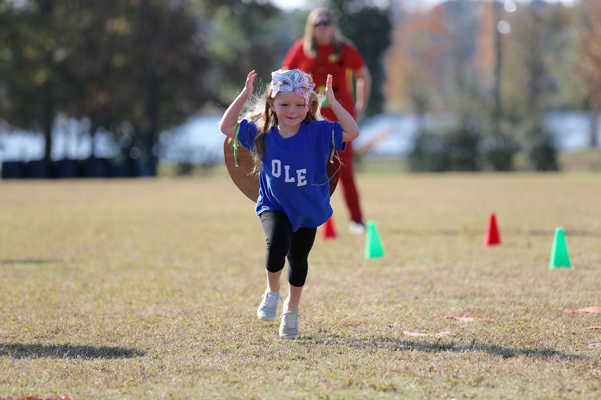 A QLE student runs in the QLE Fun Run.