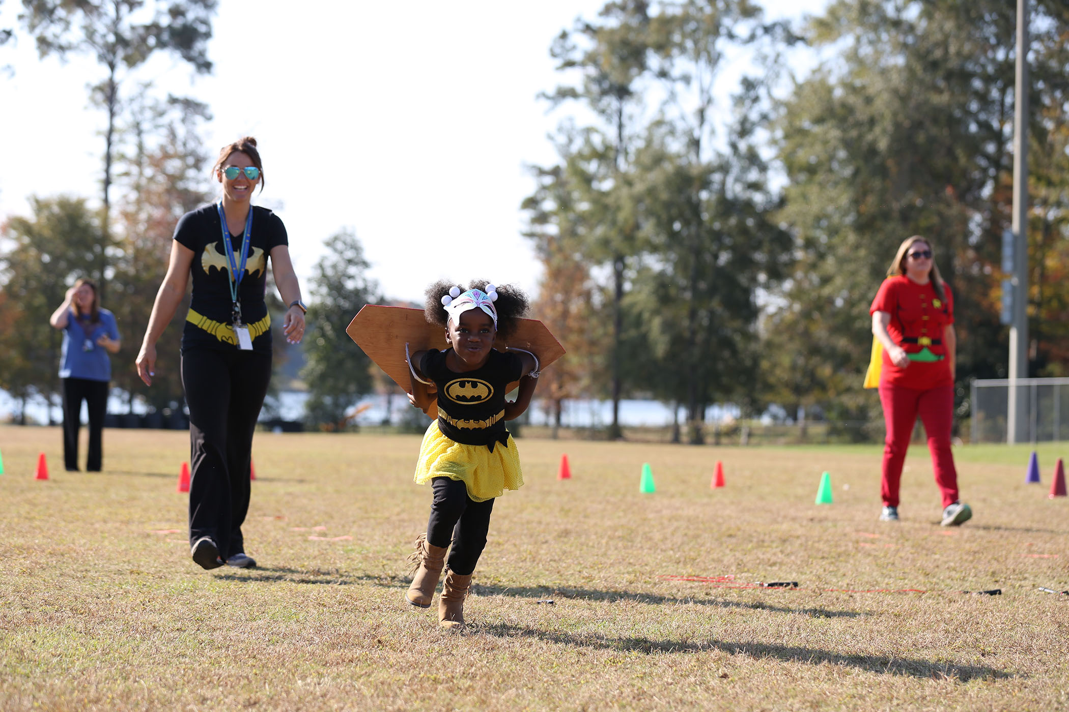 A QLE student participates in the QLE Fun Run.