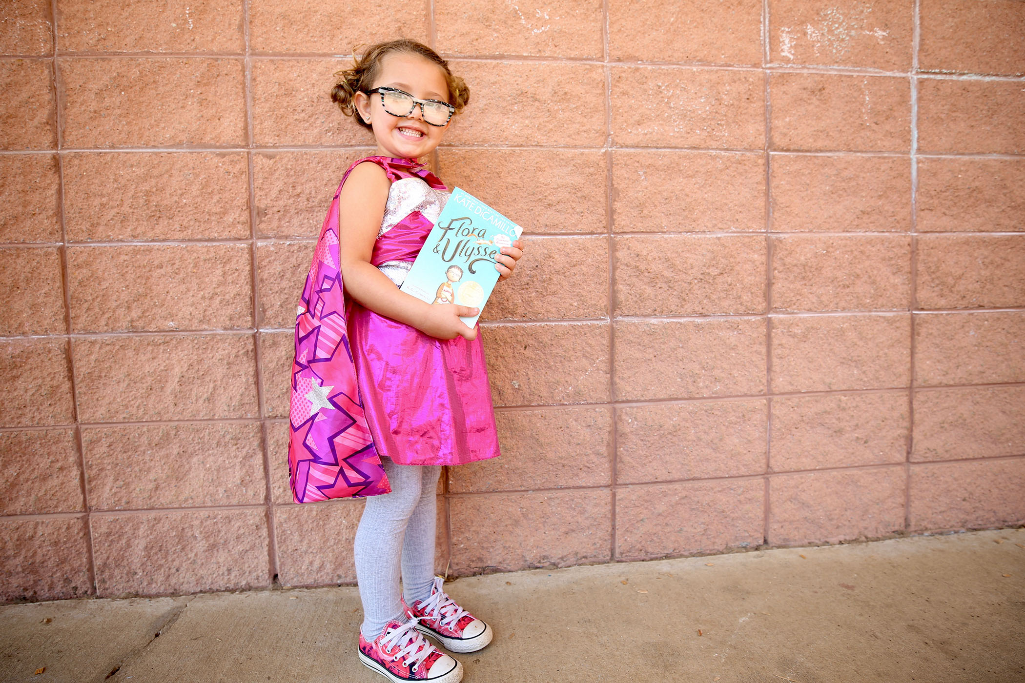 QLE student poses with a book.