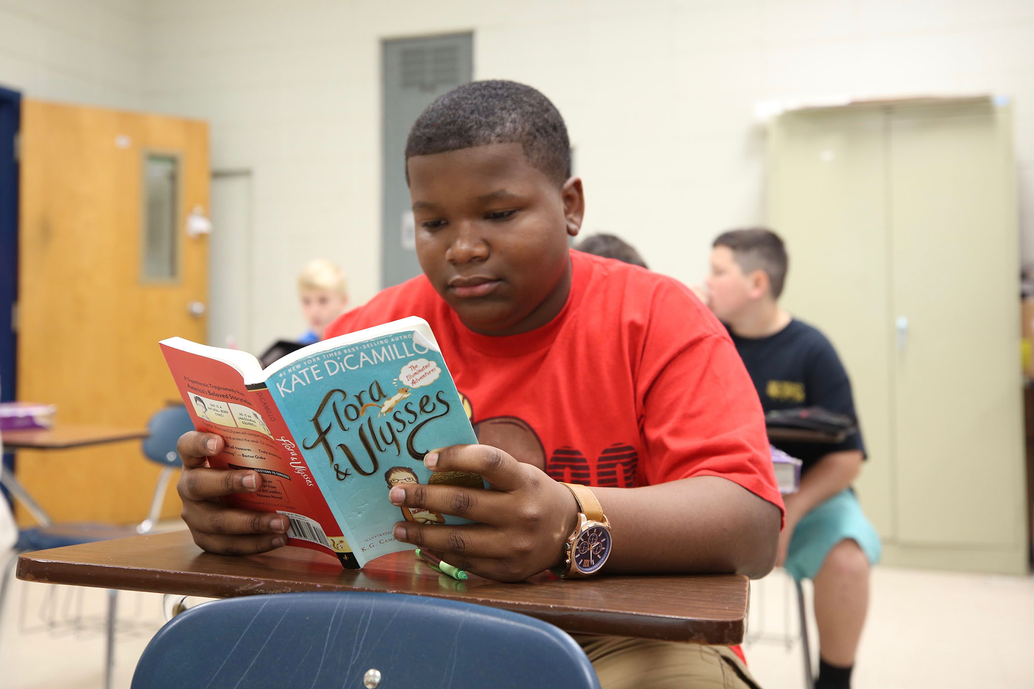 A student reads Flora & Ulysses.