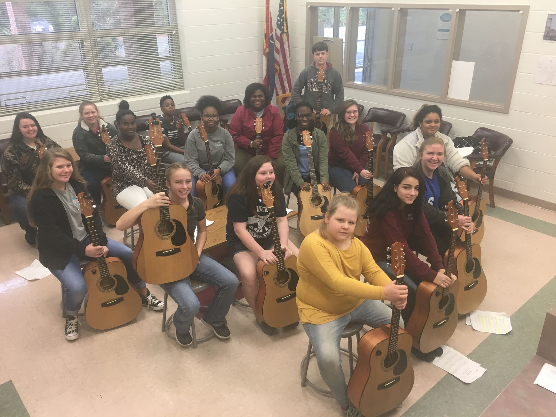 Quitman Junior High guitar students pose for a photo in the QJH office.