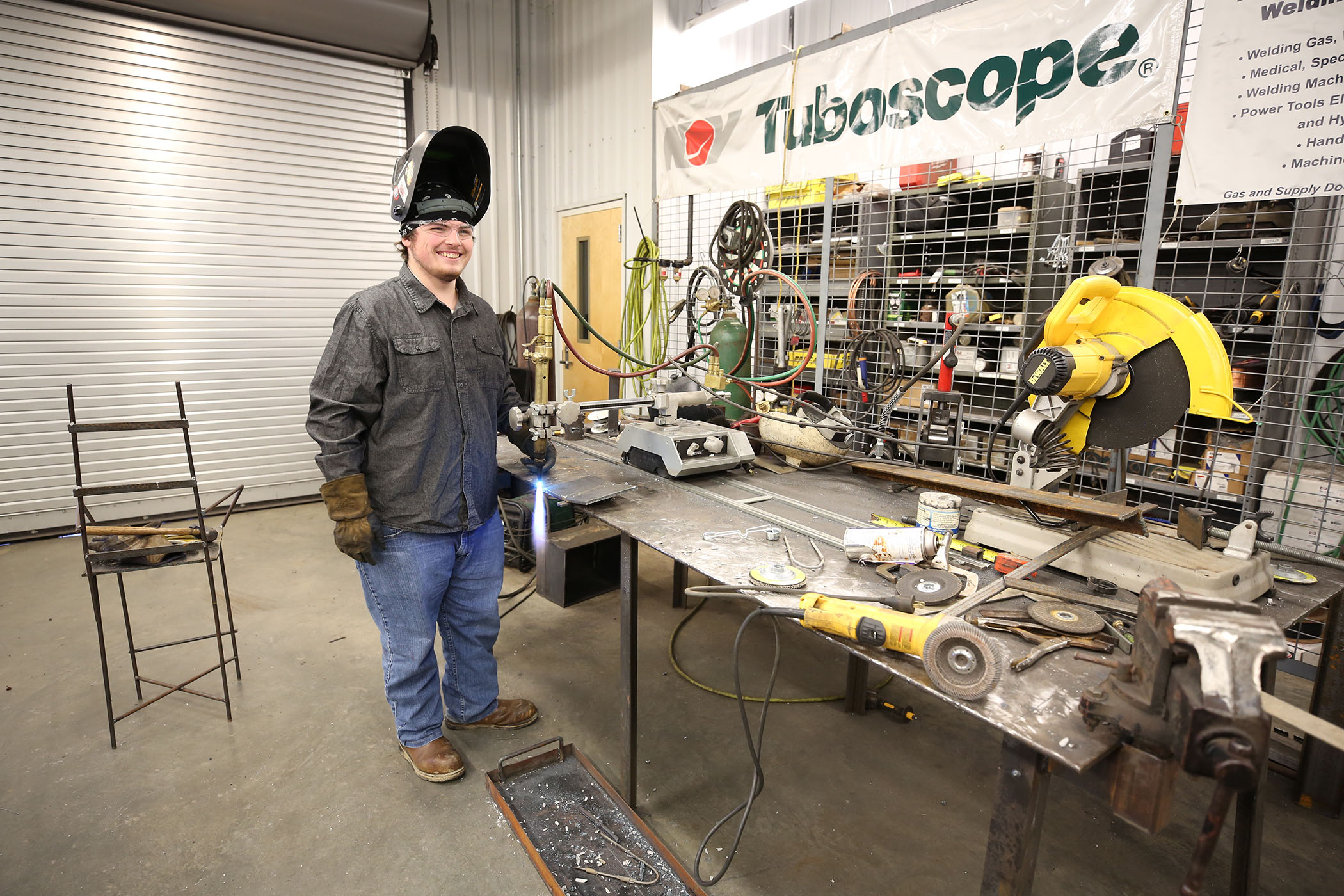 Jordan poses in the welding center of the JCJC Stonewall campus.