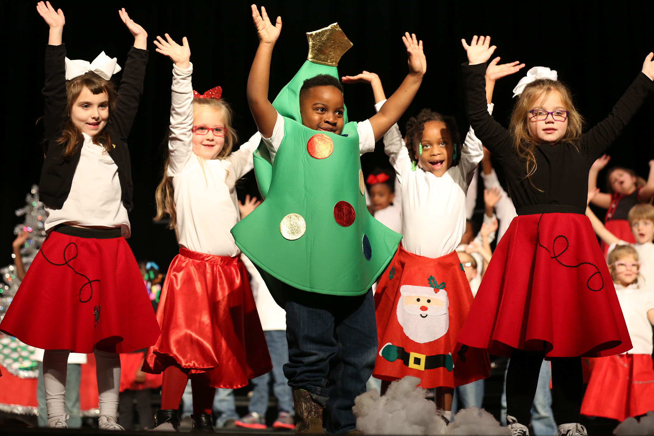 QLE kindergarteners perform their Christmas musical on stage in the QHS Auditorium.