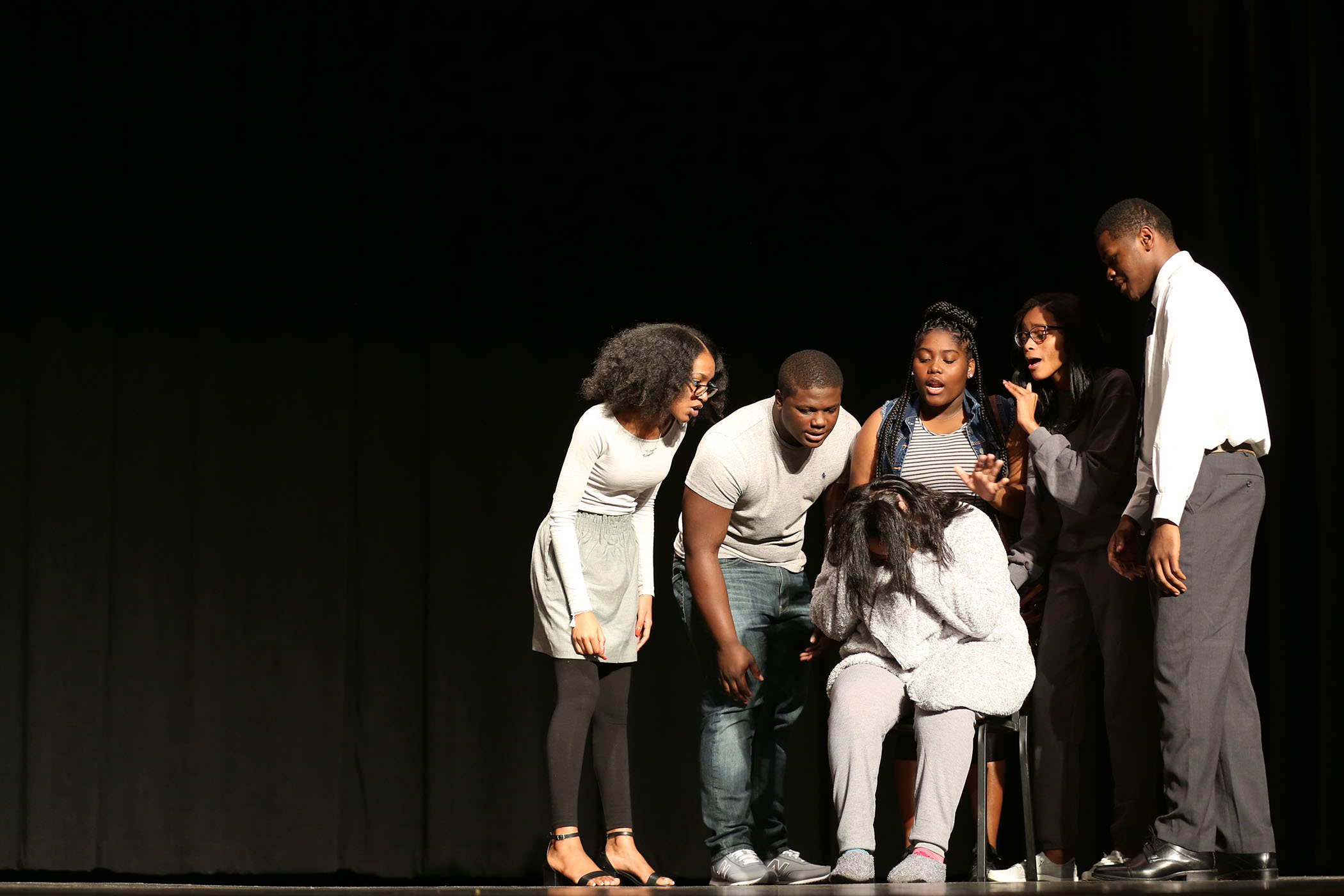 QHS theater students perform their play on stage in the QHS Auditorium.