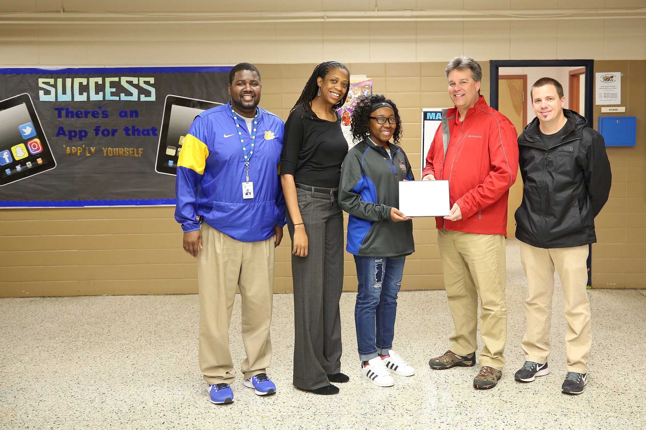 December's Alfa Insurance Athlete of the Month poses with Dr. Savage, Coach Westerfield, Dr. Hampton, and Coach Jordan.