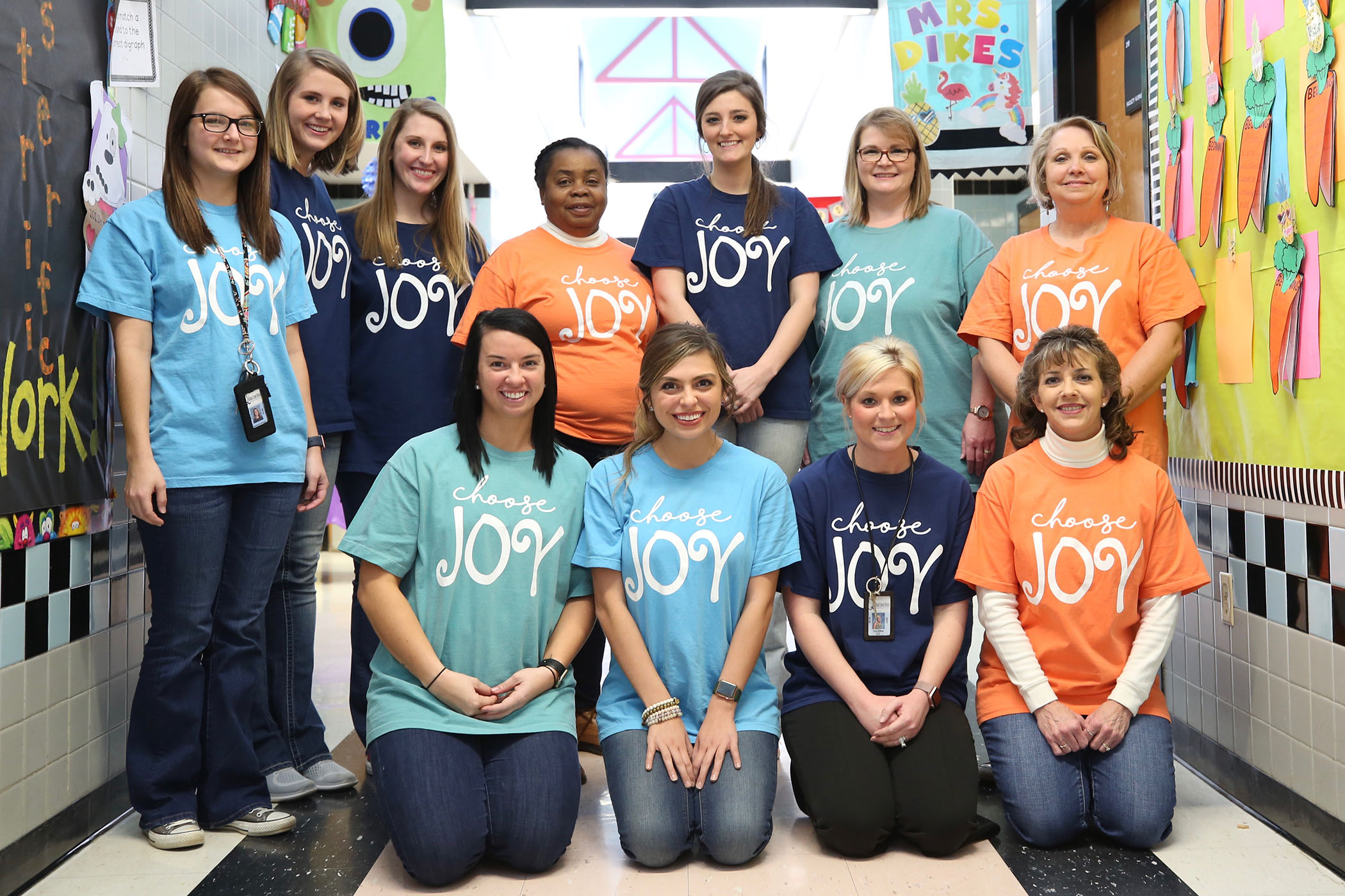 "Staff and faculty pose for a ""Choose Joy"" photo at QLE."