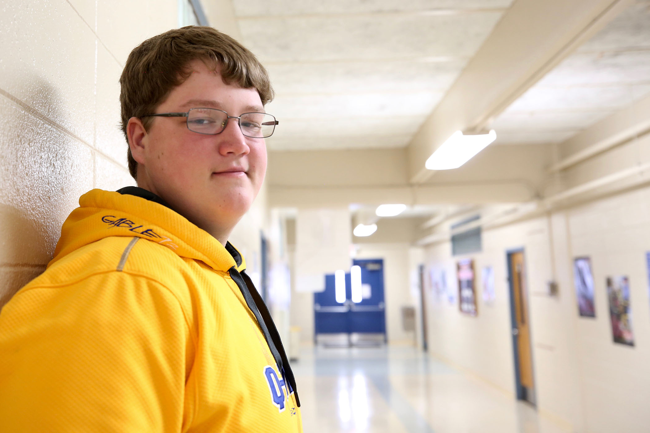 Clayton poses for a photo in the hallway of the Career Tech Center.