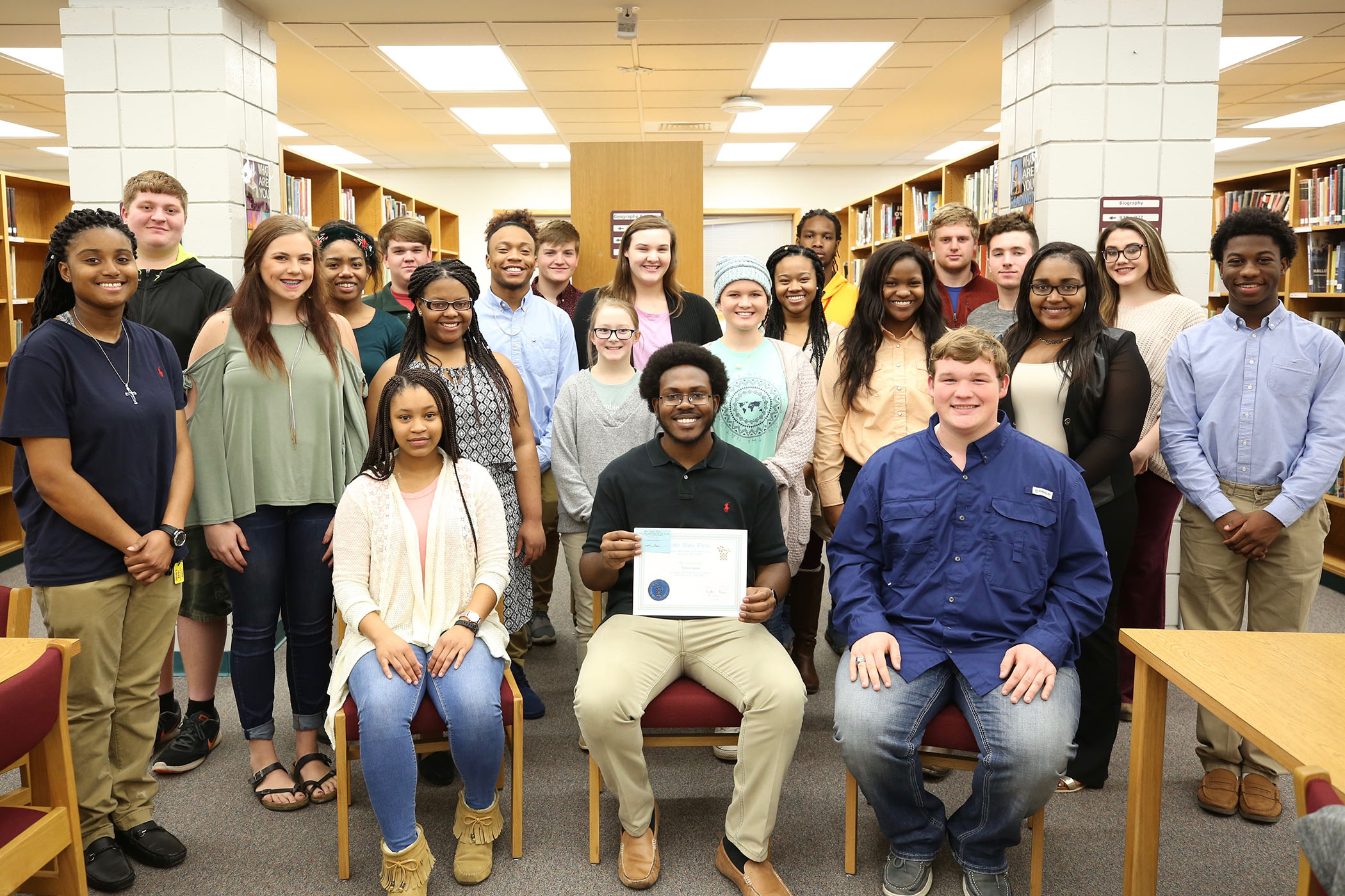 Mu Alpha Theta members pose for a group photo.
