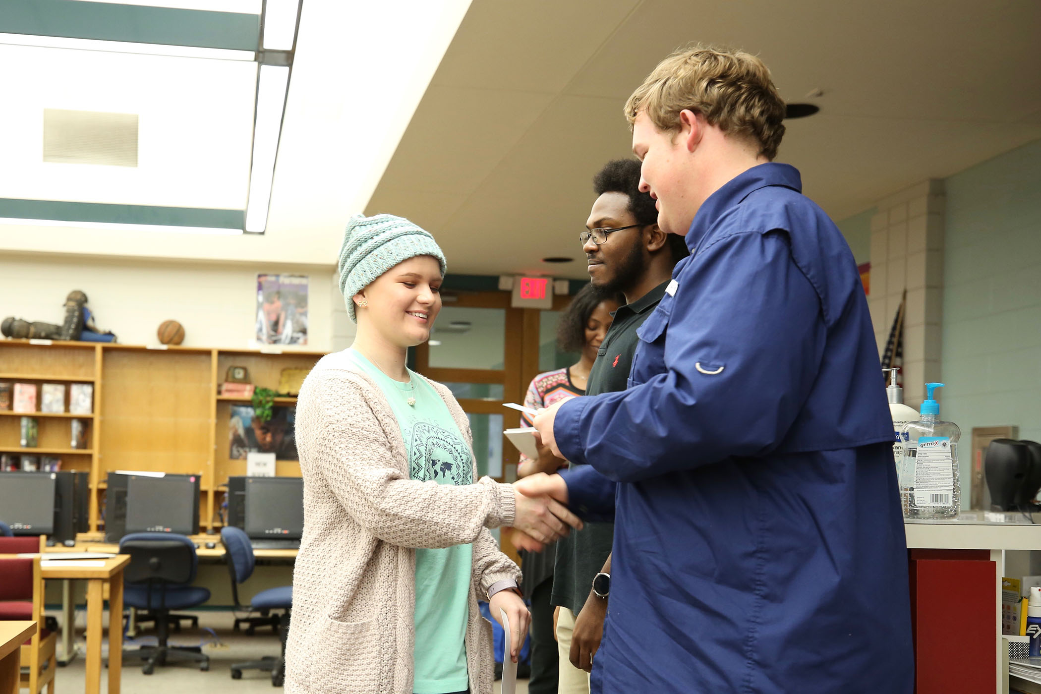 Mu Alpha Theta president and vice-president hand out certificates and cards to members.