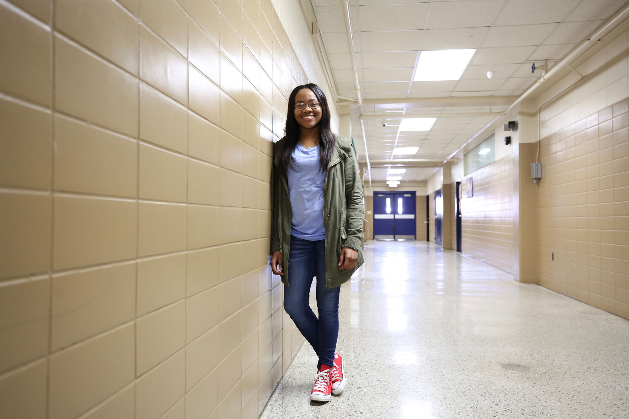 Amiya poses in the hallway.