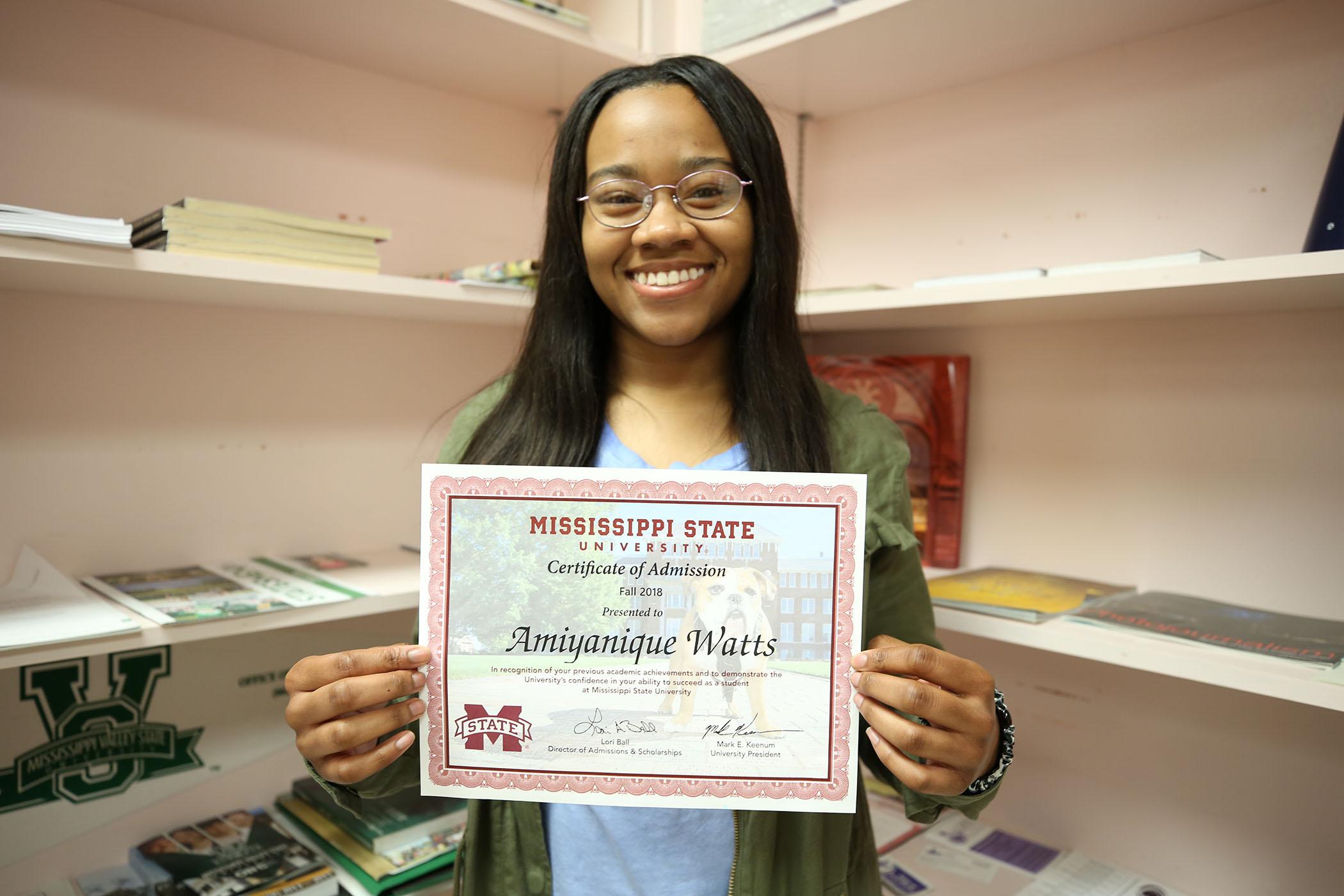 Amiya holds her admission letter to Mississippi State University.