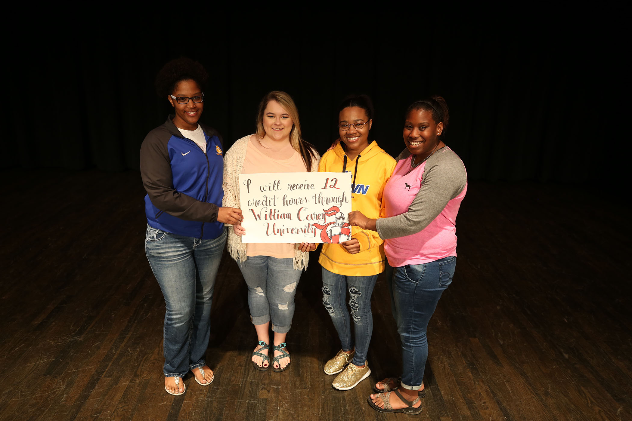 Amiya stands with her classmates who will graduate high school with twelve college credit hours.