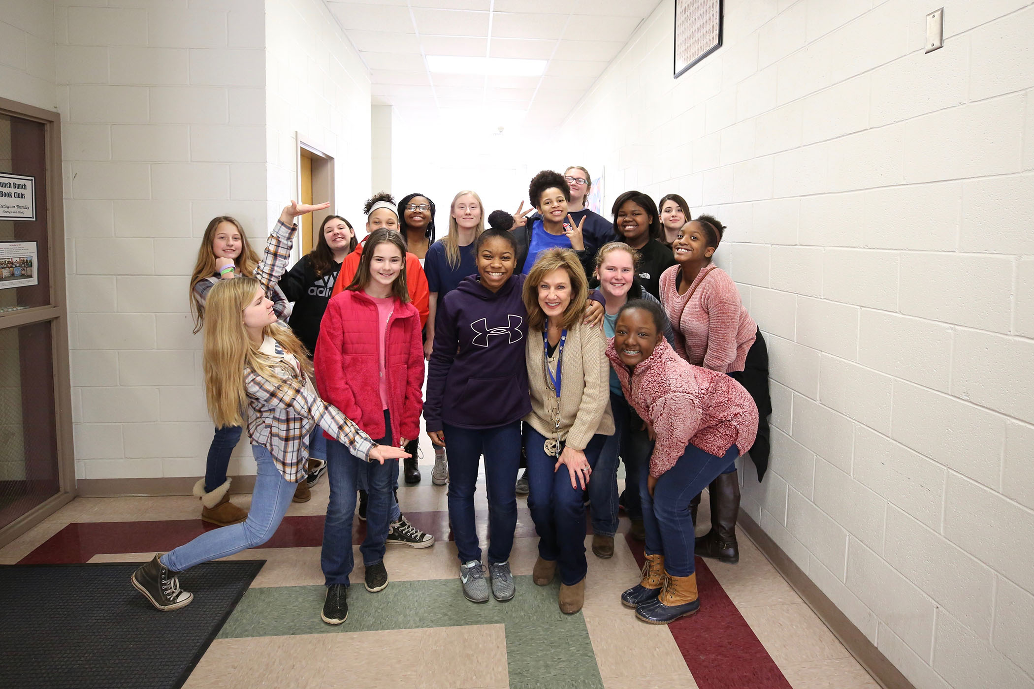 18 QHS students were chosen for the MSU Bagley School of Engineering I AM GIRL Program. They pose for a photograph.