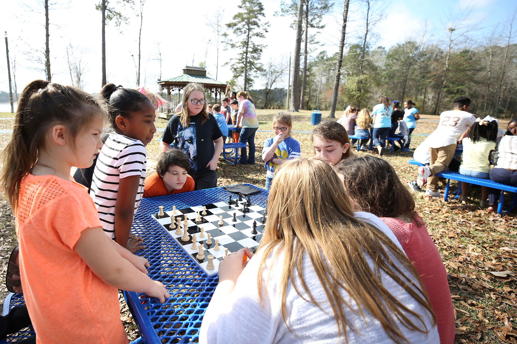SWAT students play chess on their new outdoor tables.