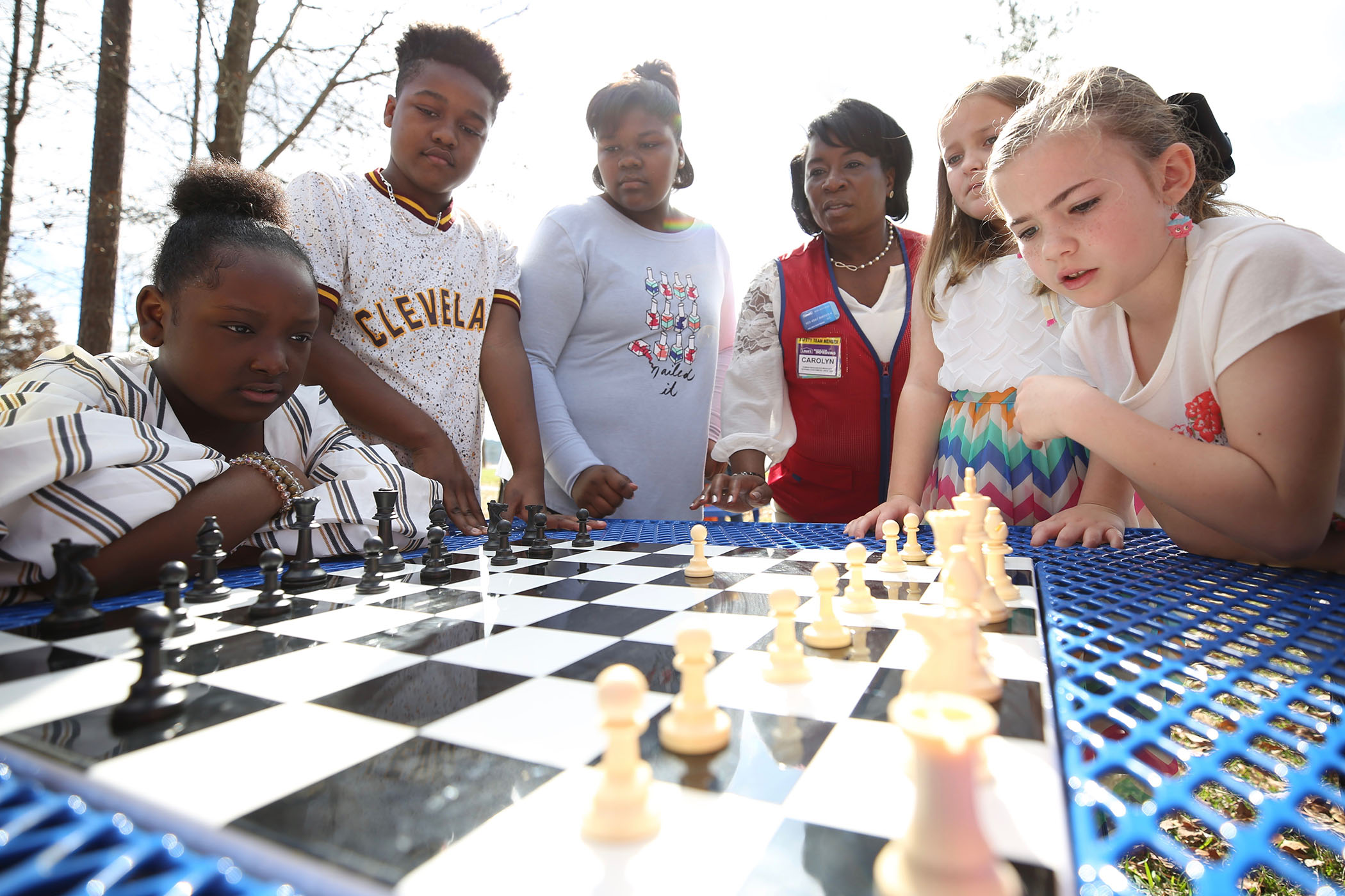 SWAT students play chess on their new outdoor table.