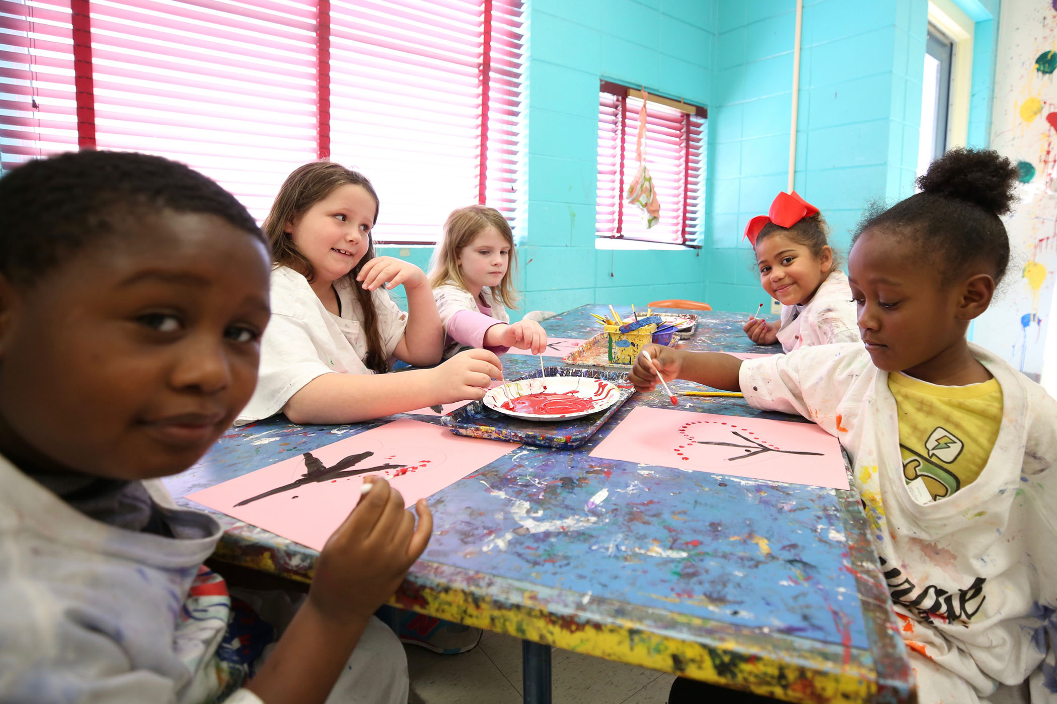 QLE students enjoy art class.