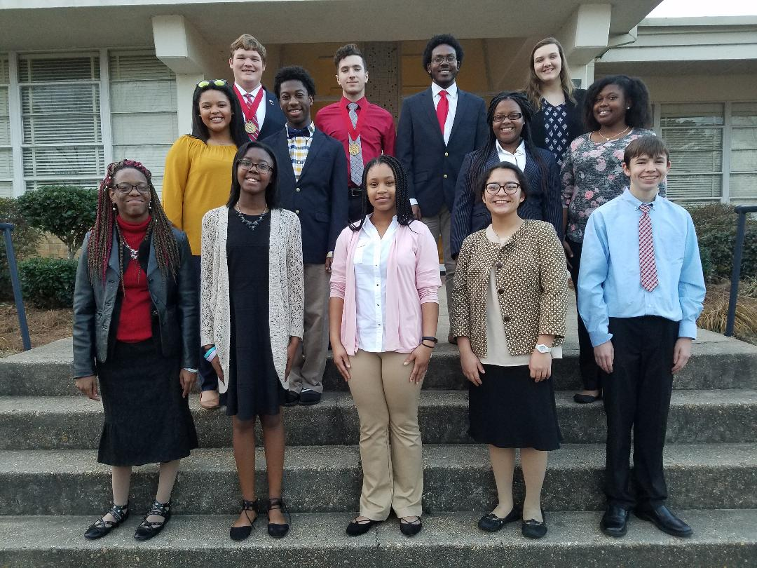 Scottie stands with FBLA district competition winners.