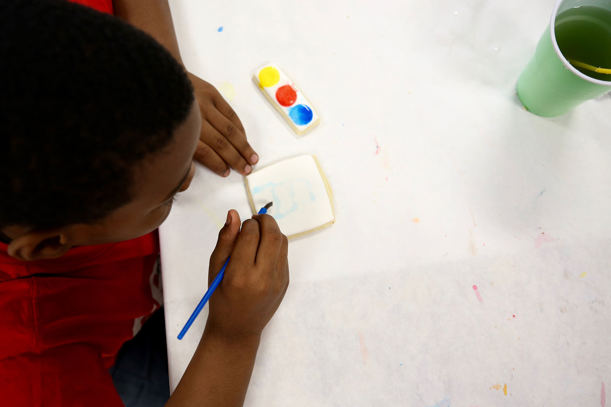 QLE students paints on his edible canvas.