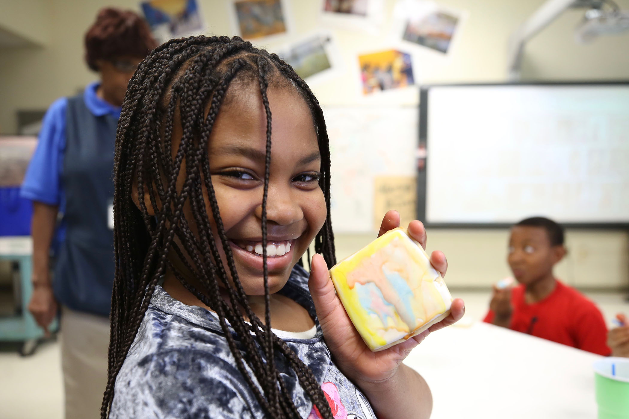 QLE student poses with her edible art.