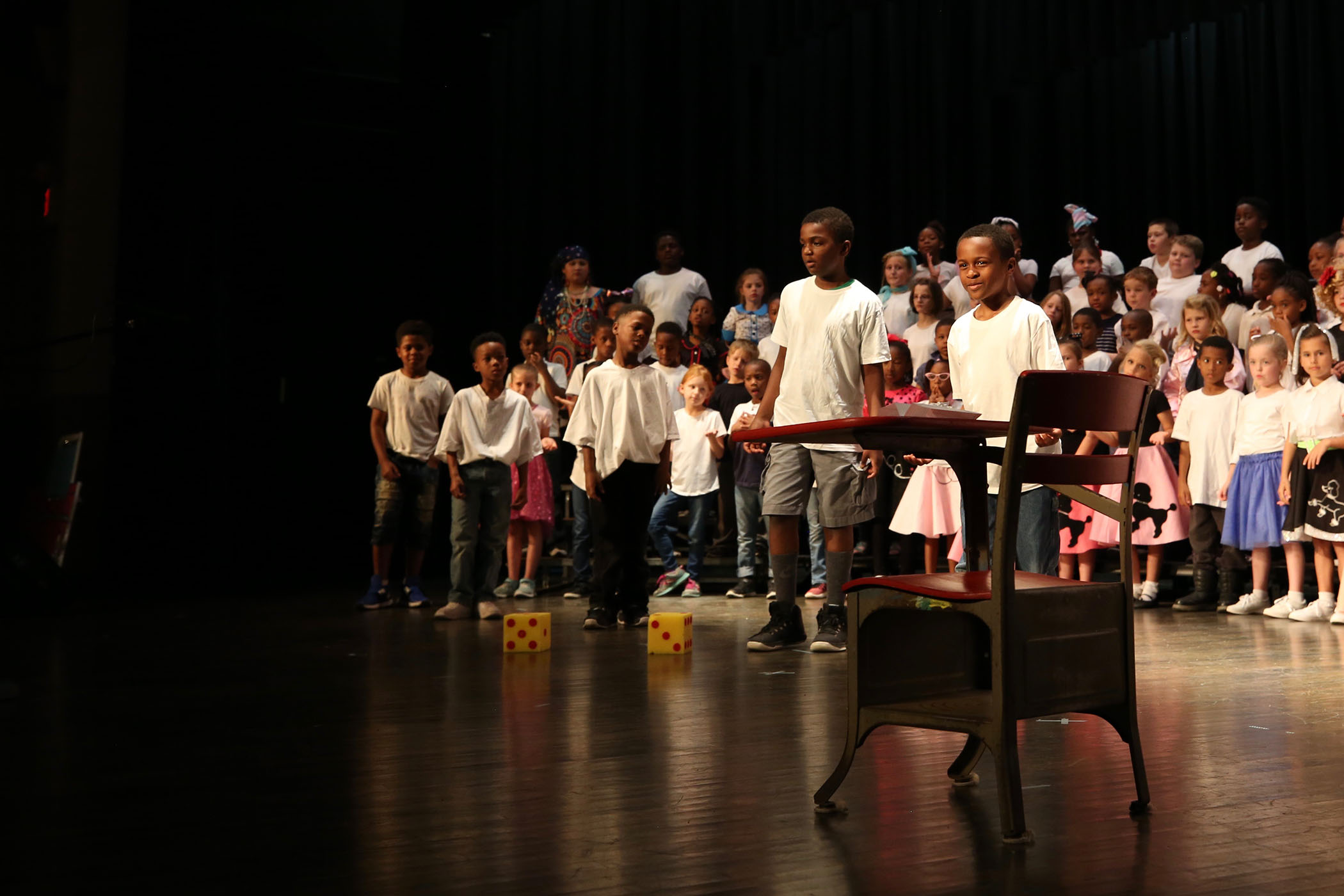 QLE second-graders perform on stage in the QHS Auditorium.