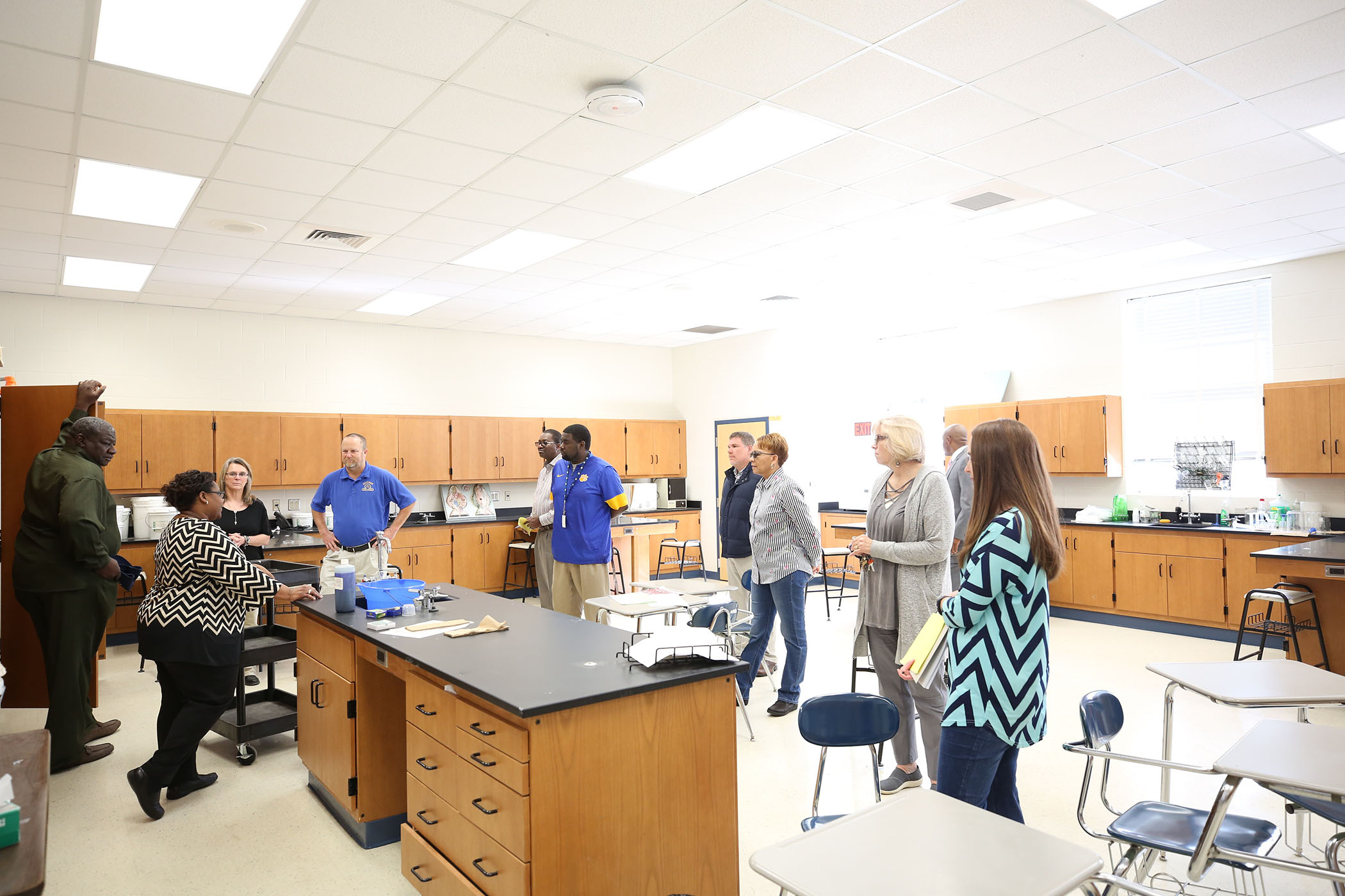 QSD School Board meets with QHS science teachers in the school's science building.