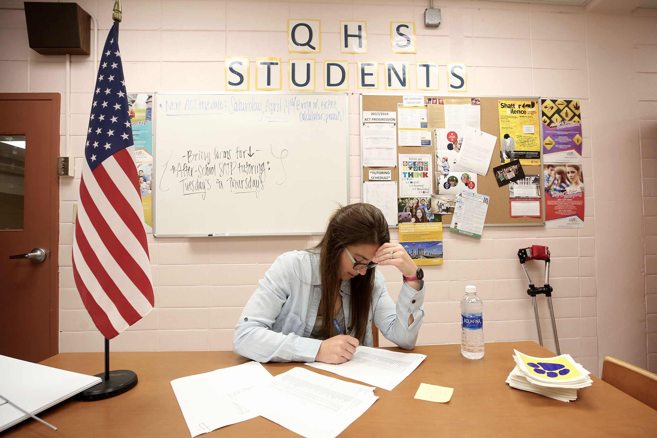 QHS counselor Natalie Faucette works hard as graduation nears.