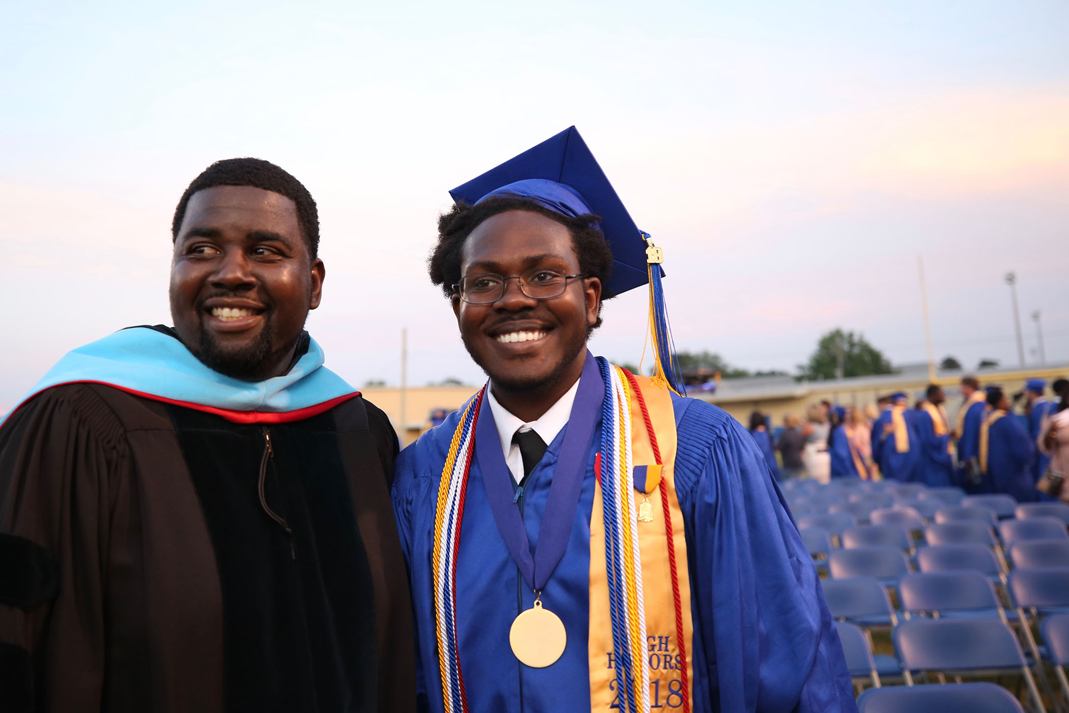 The QHS Valedictorian stands with Dr. Savage after graduation.