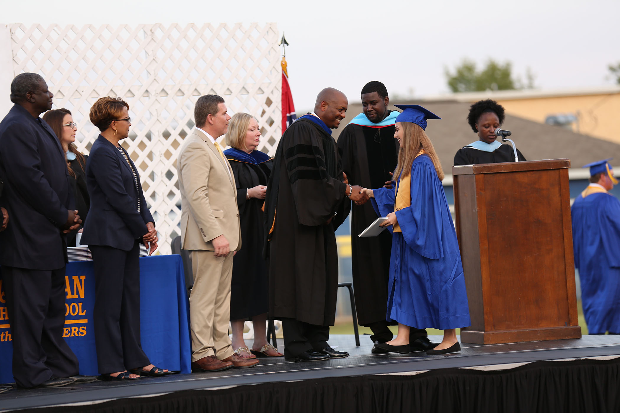Dr. Holloway shakes the hand of a 2018 QHS Graduate.
