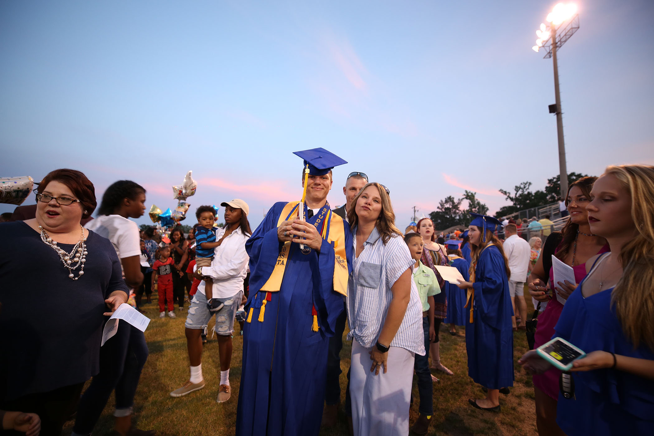 QHS graduate poses with his mom.