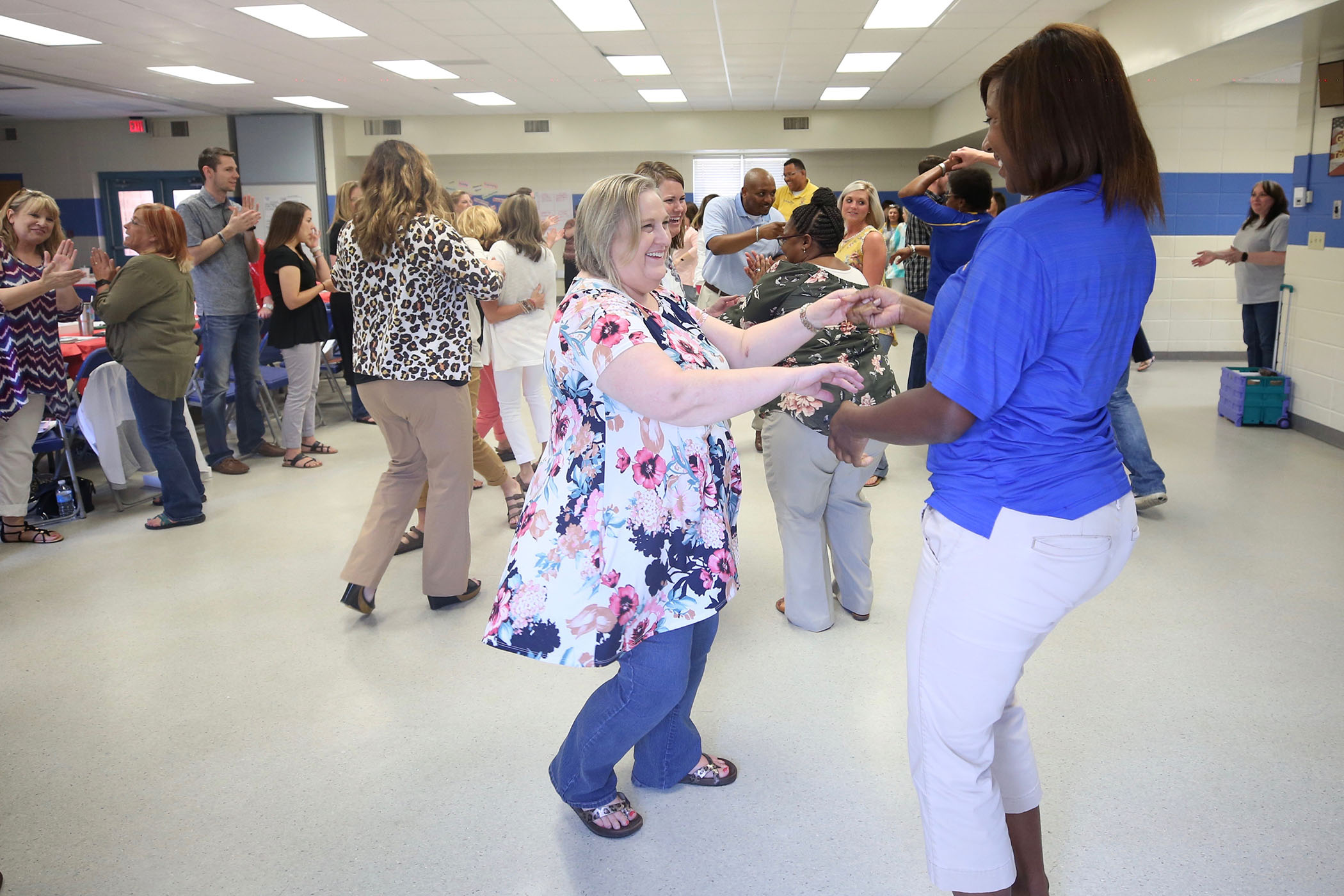Quitman School District employees dance together at a Leader in Me conference.