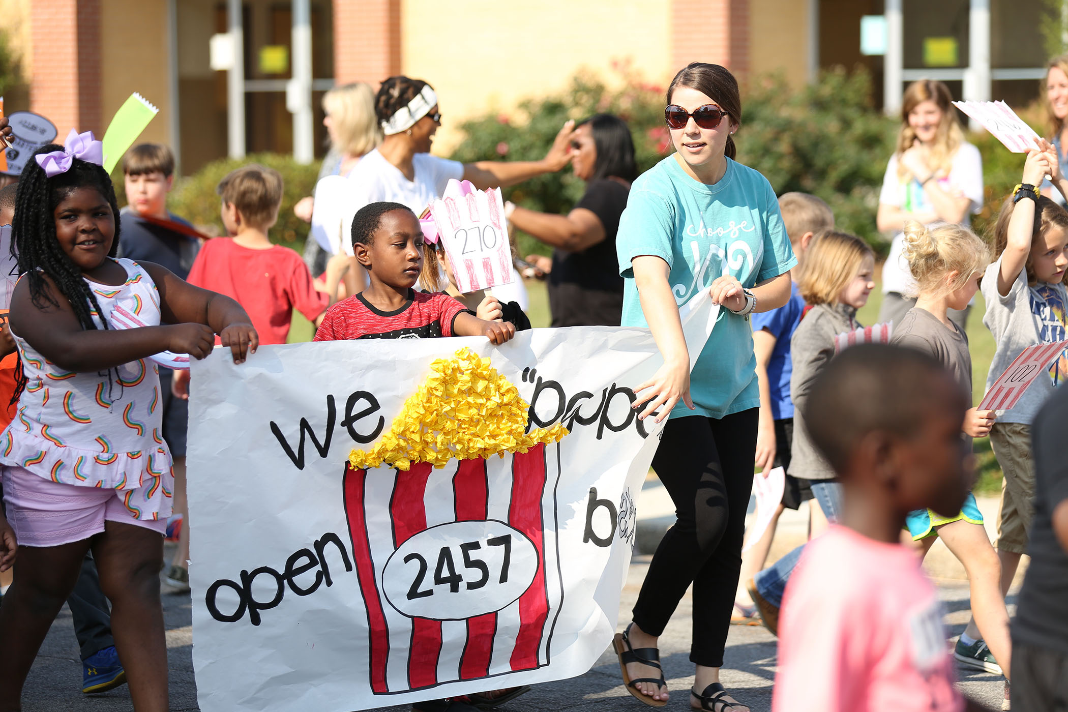 QLE students and teachers march in the annual AR Parade.