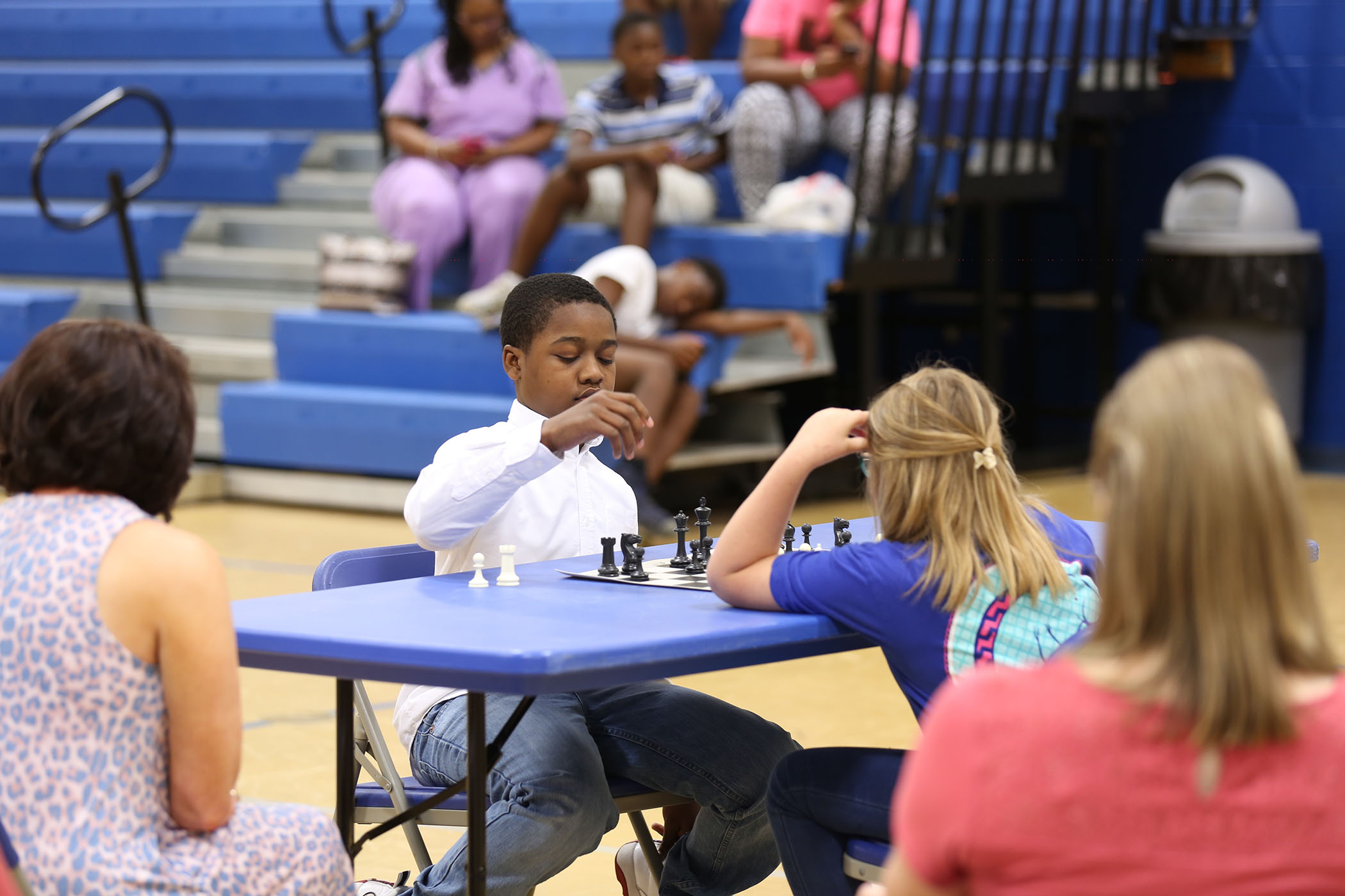 Chess players shake hands after a hard fought championship match.