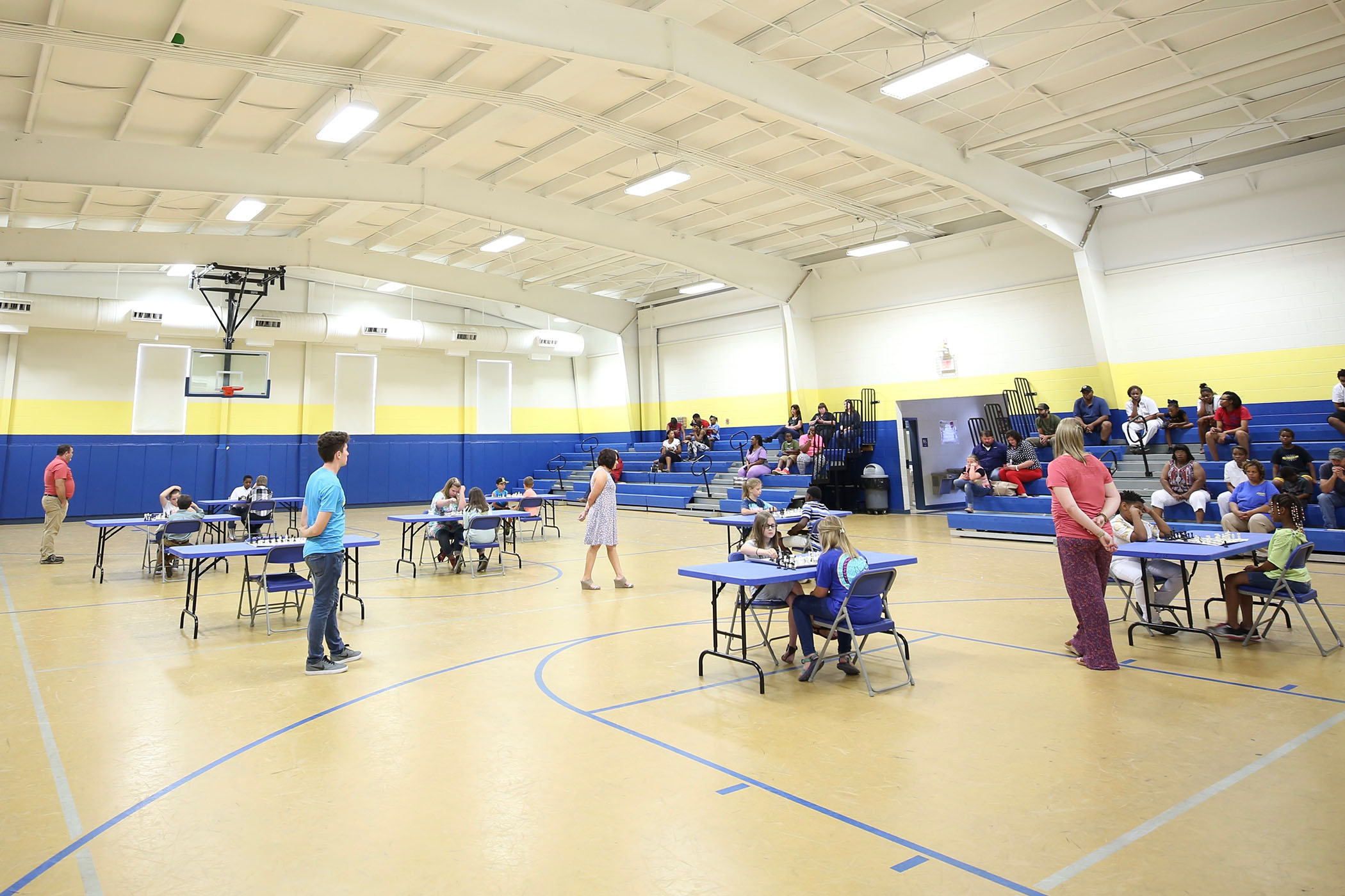 SWAT Chess Tournament matches take place in the QUE Gymnatorium.