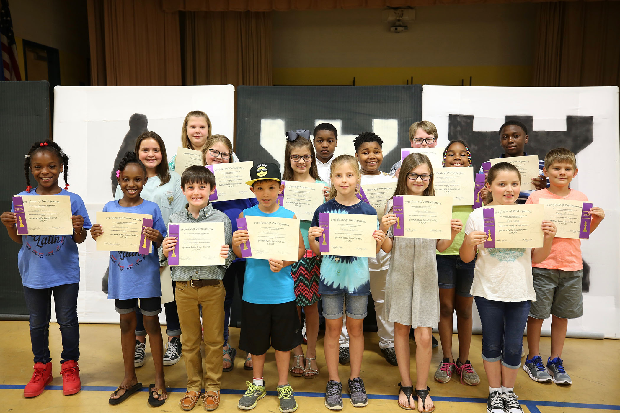 The students who qualified for the 2018 SWAT Chess Tournament pose for a photo.