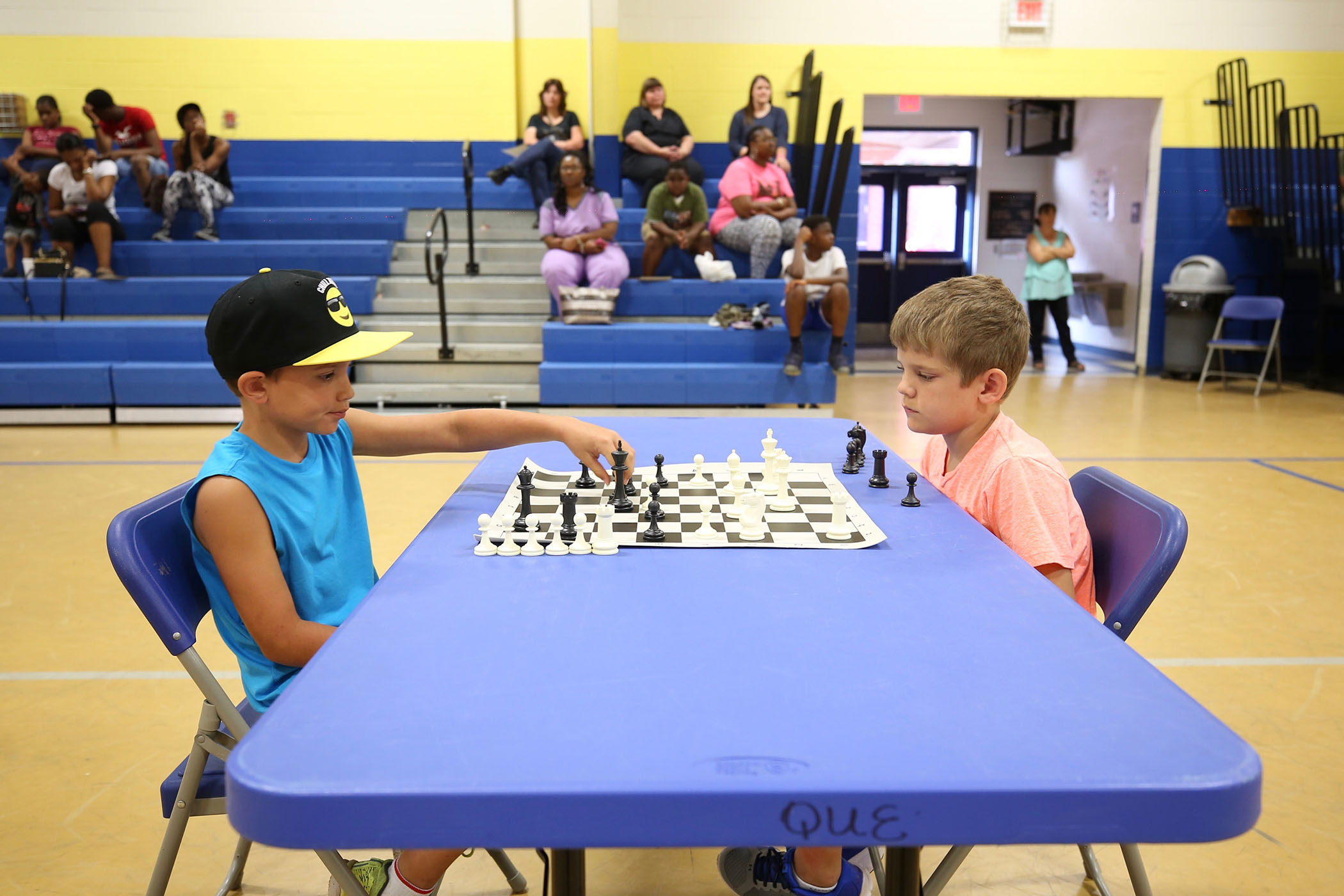 Two players compete in the 2018 SWAT Chess Tournament.