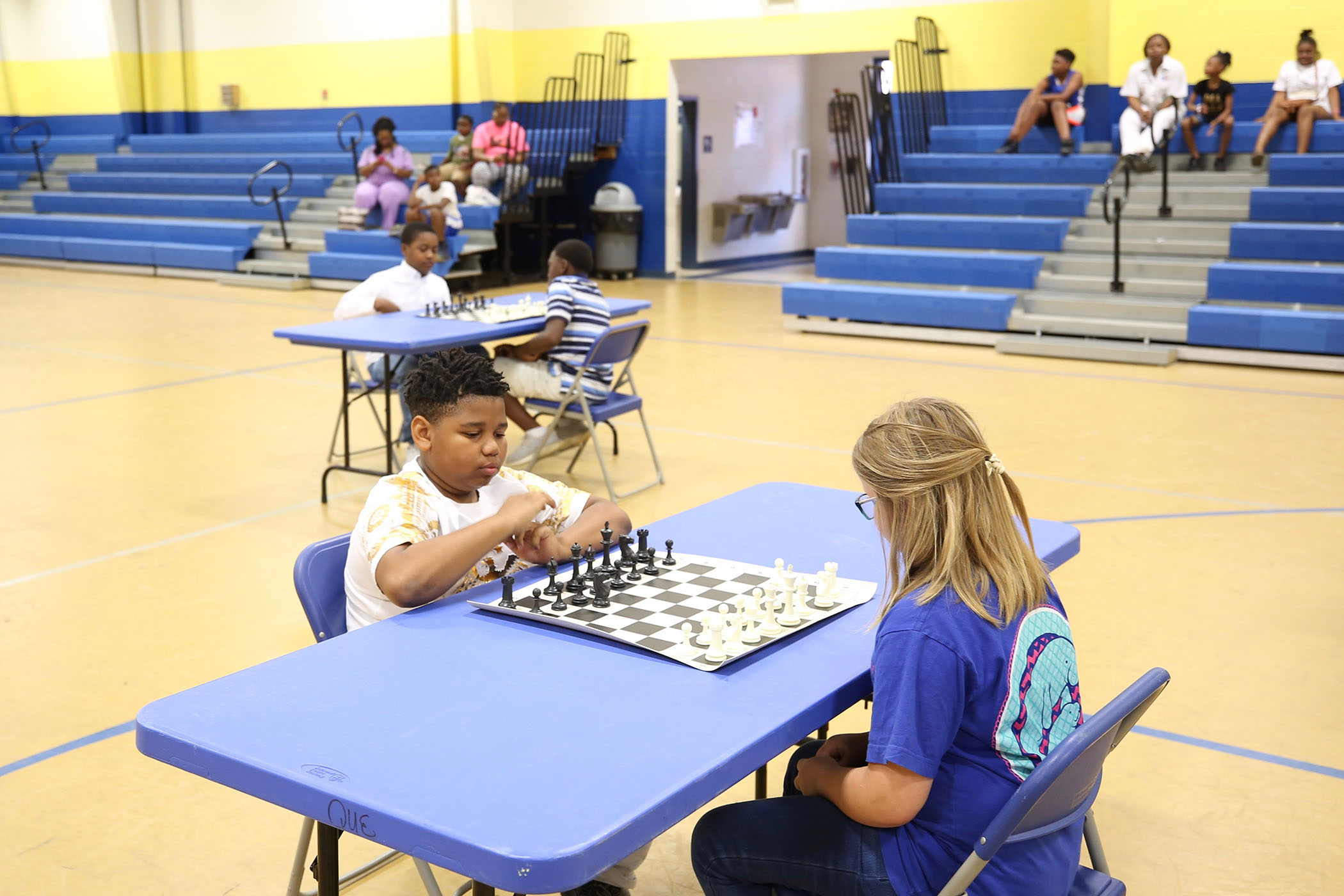 Students compete in the quarter finals of the 2018 SWAT Chess Tournament.