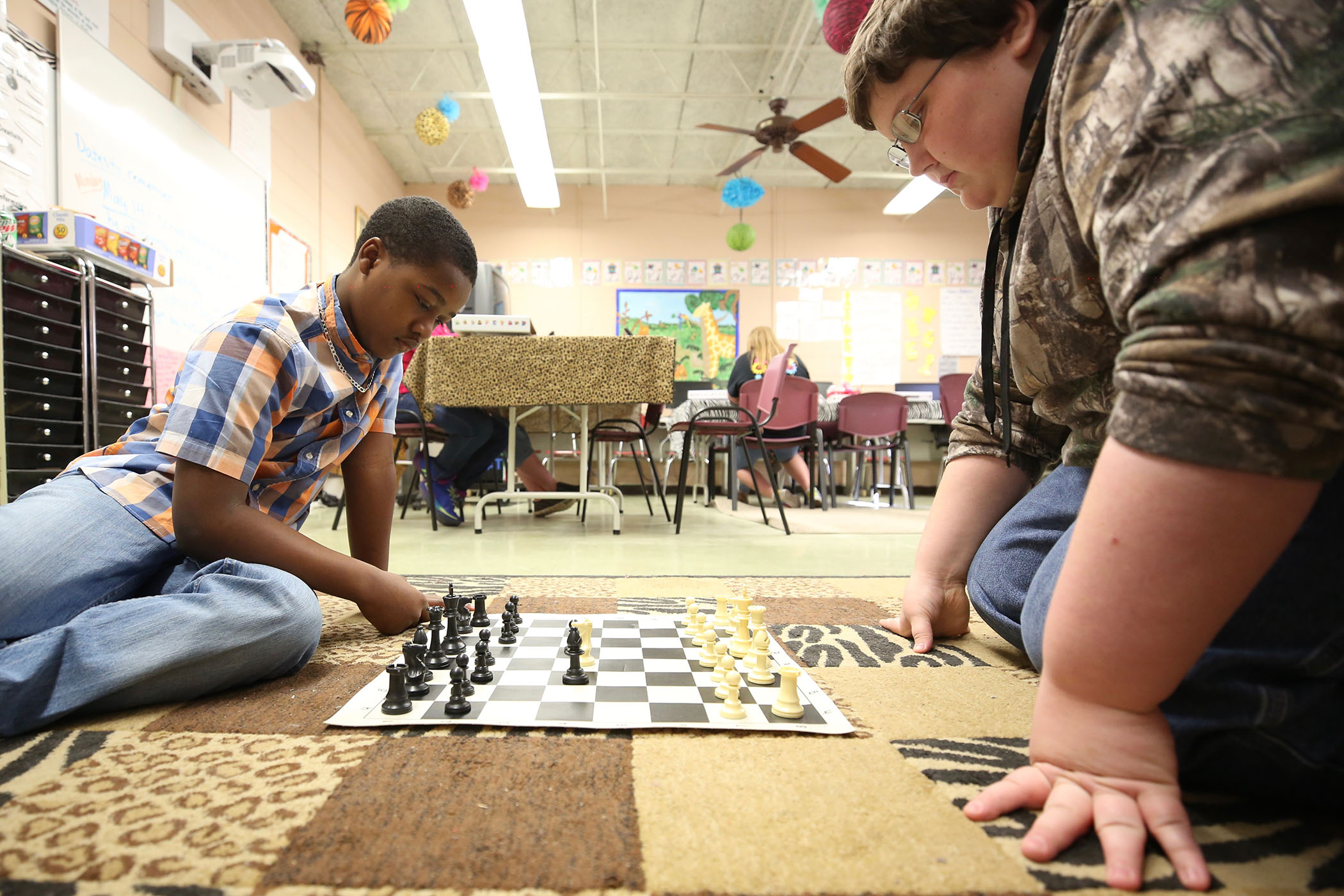 QJH SWAT students practice for the upcoming chess tournament.