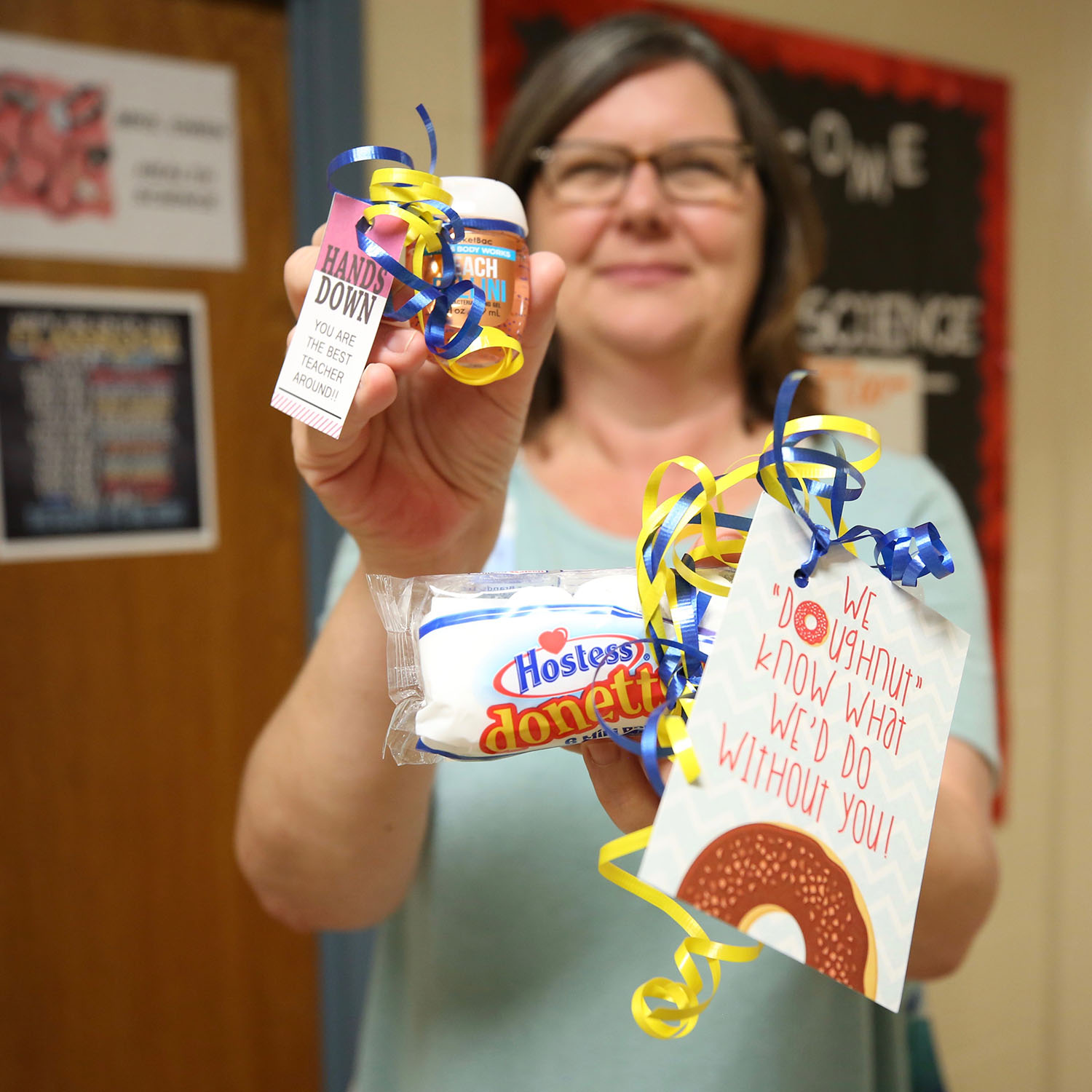 Career Tech teacher poses with gifts.