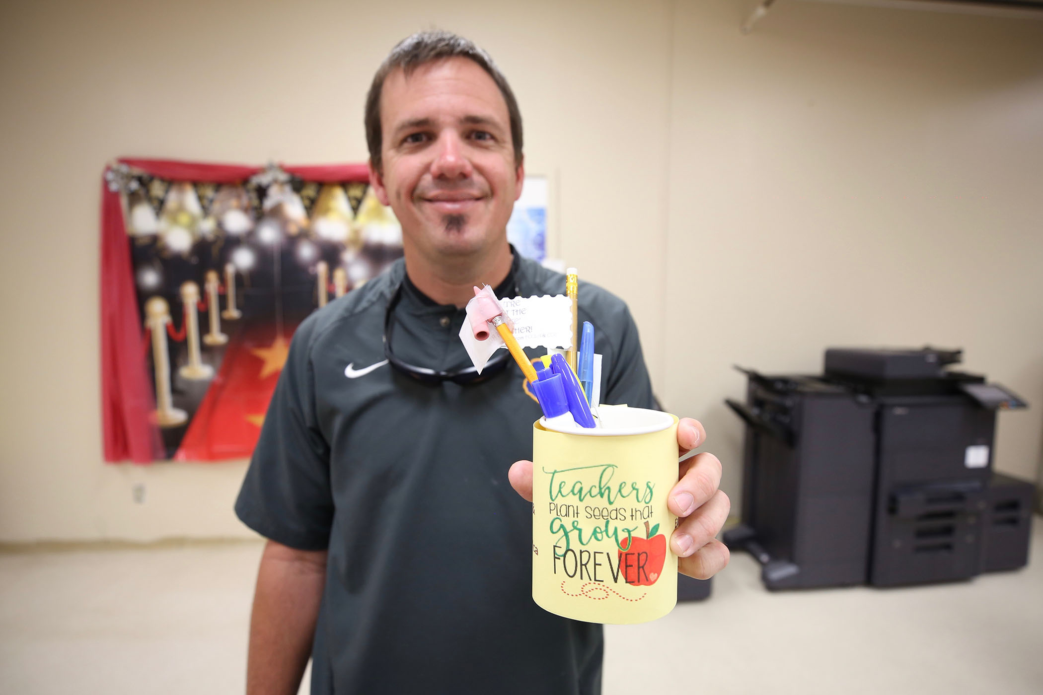A QHS teacher holds a gift during teacher appreciation week.